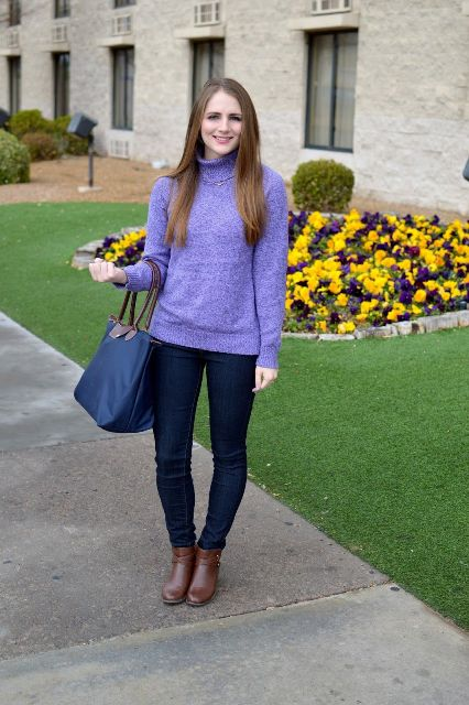 With navy blue jeans, navy blue tote bag and brown leather boots
