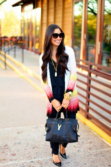 With navy blue top, black tote bag, black pants and pumps