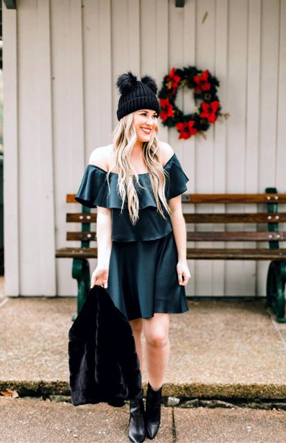 With off the shoulder ruffled dress, black fur jacket and black leather boots