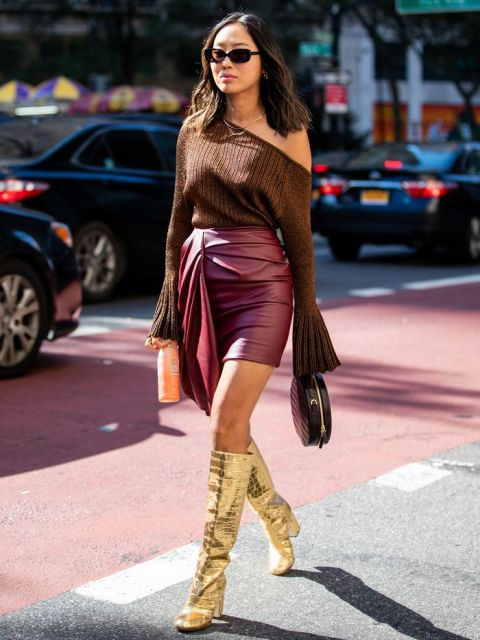 With one shoulder bell sleeved blouse, marsala leather mini skirt and rounded bag