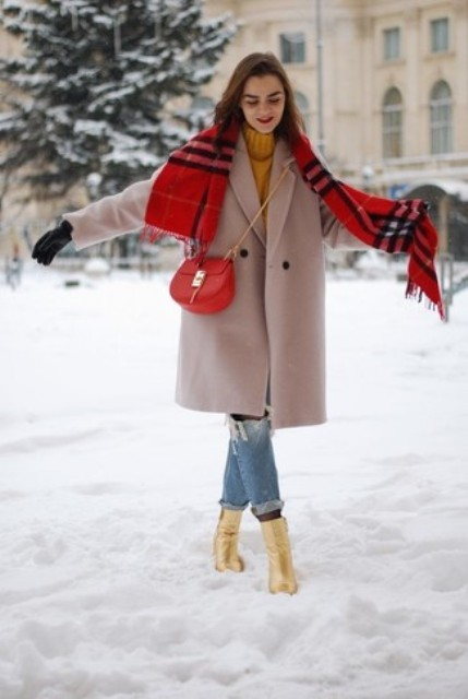 With orange sweater, pale pink coat, distressed jeans, plaid scarf and chain strap bag