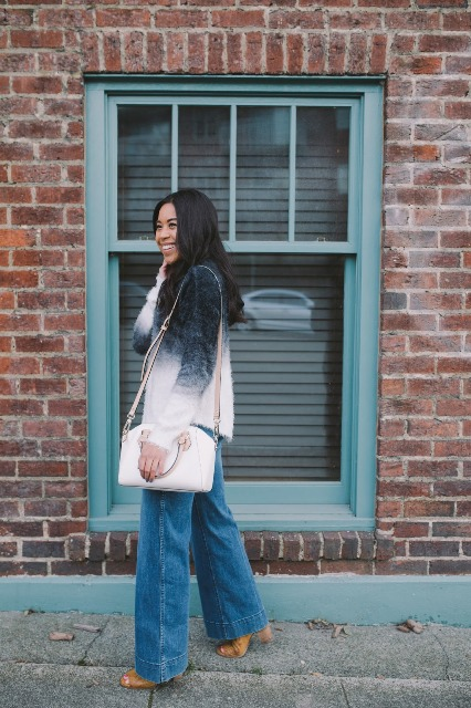 With palazzo jeans, white bag and brown heeled shoes