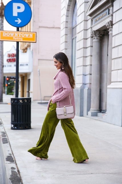 With pale pink loose sweater, lilac bag and pale pink high heels