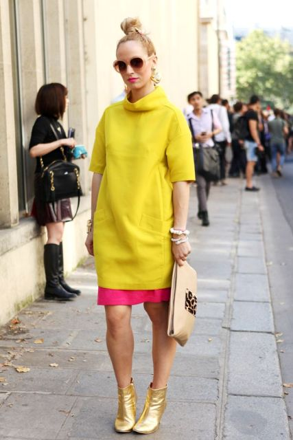 With pink skirt, clutch and yellow long sweatshirt