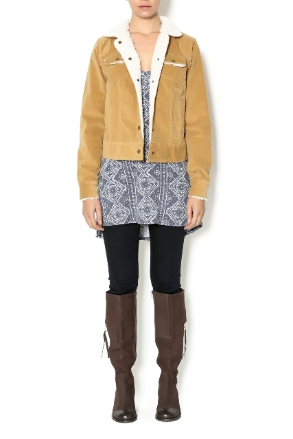 With printed shirt, black skinny trousers and brown high boots