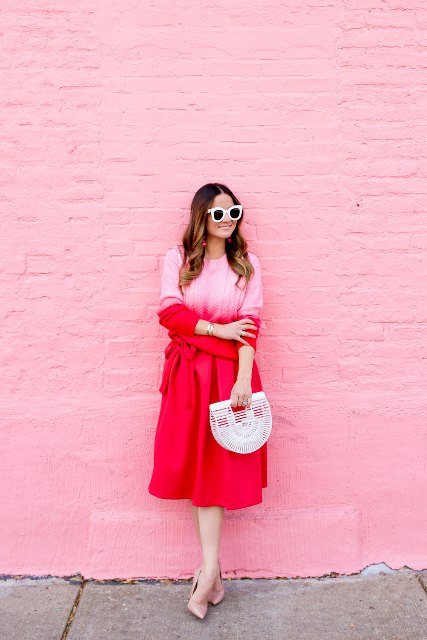 With red midi skirt, bag and pale pink pumps
