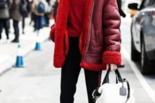 With red sweater, red jacket, black flare pants and black and white bag