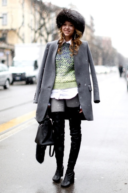 With shirt, gray jeans, gray coat, fur hat, black bag and black over the knee boots