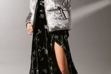 With silver puffer jacket and printed maxi dress