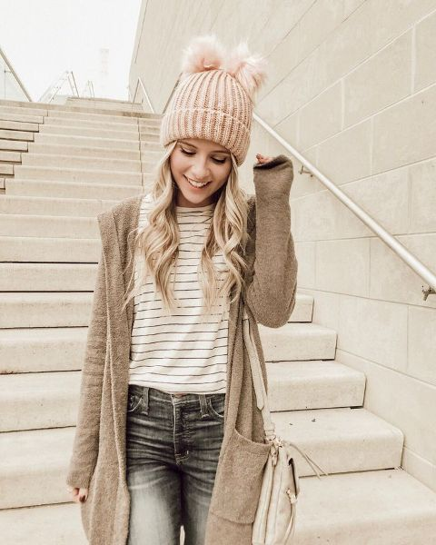 With striped shirt, long cardigan, jeans and white bag