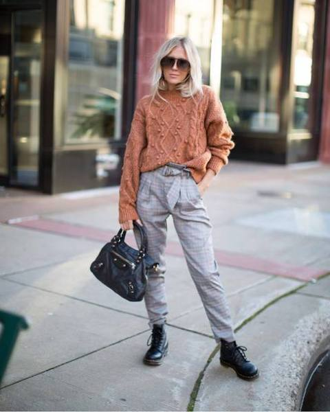 With sweater, black bag and black lace up flat boots