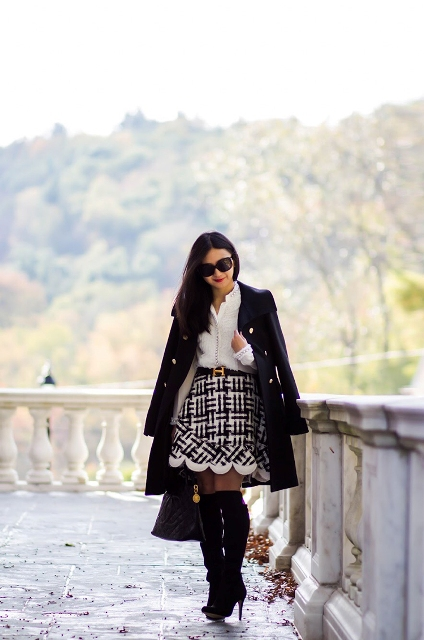 With white blouse, black coat, black bag and suede over the knee boots