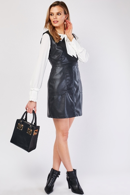 With white blouse, black heeled boots and black bag