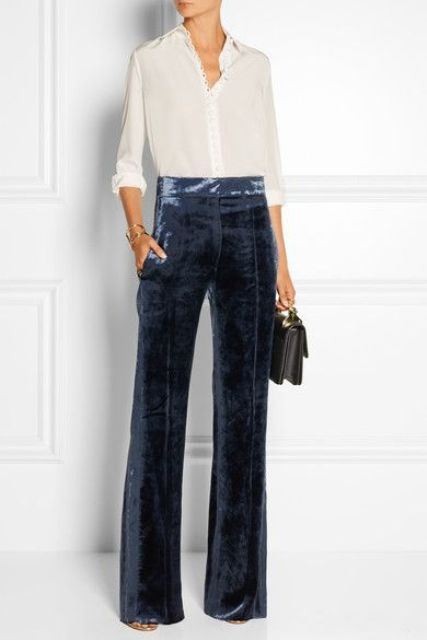 With white button down blouse, high heels and leather bag