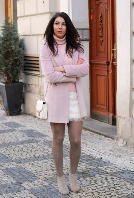 With white fringe mini skirt, gray suede ankle boots, pale pink coat and white chain strap bag