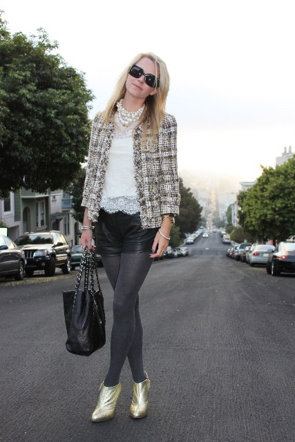With white lace blouse, tweed blazer, black leather shorts, gray tights and black tote bag