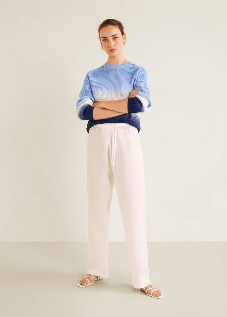 With white loose pants and flat shoes