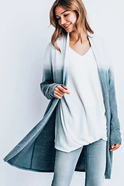 With white loose shirt and light blue jeans