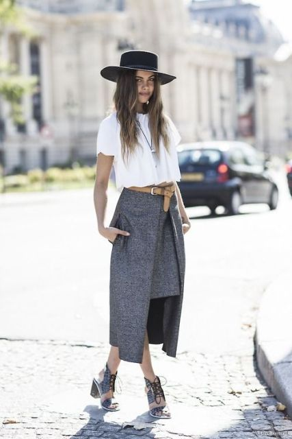 With white loose shirt, black hat and cutout shoes