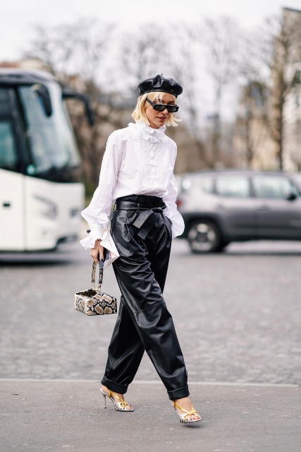 With white ruffled blouse, black leather beret, snake printed bag and high heels