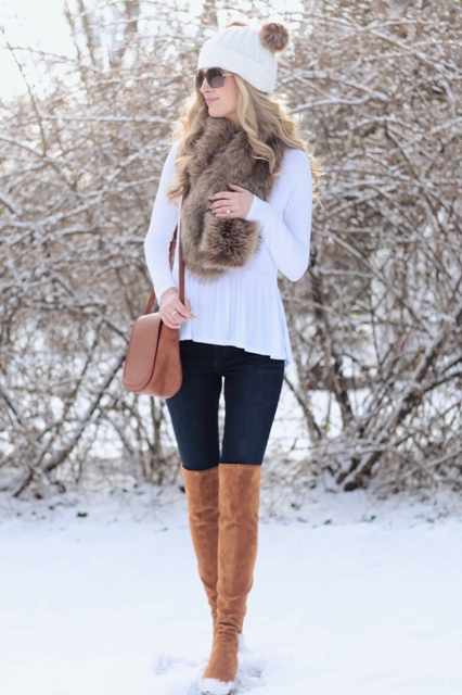 With white ruffled shirt, fur scarf, brown leather bag, skinny jeans and brown suede over the knee boots