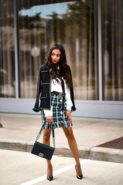 With white shirt, black blazer, leather bag and pumps