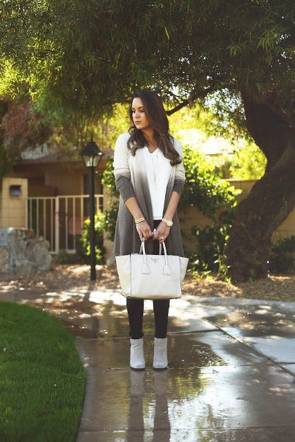With white shirt, black trousers, beige tote bag and gray suede ankle boots