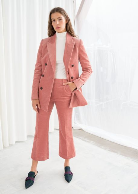 With white shirt, pale pink corduroy long blazer and checked mules