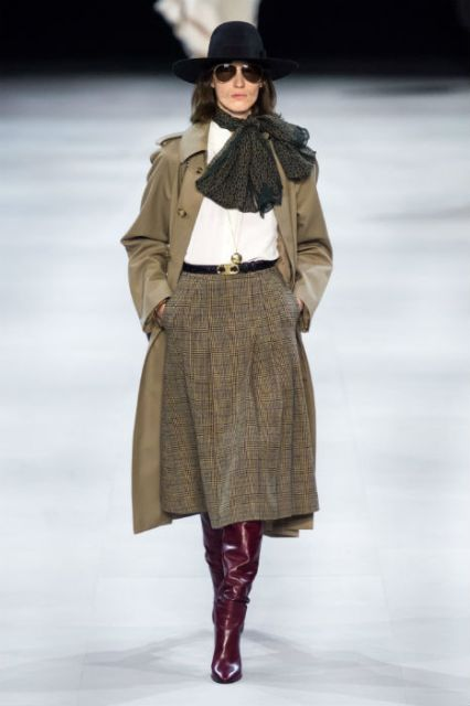 With white shirt, printed scarf, olive green coat, hat and marsala leather high boots