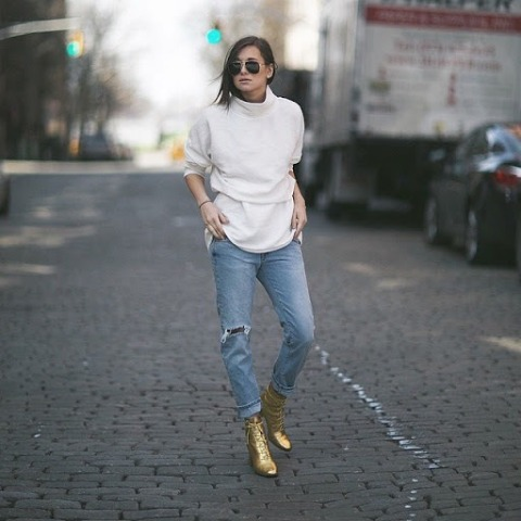 With white shirt, white crop turtleneck and distressed cuffed jeans