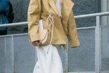 With white shirt, white culottes, beige bag and beige belted jacket