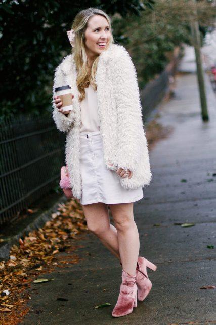 With white shirt, white mini skirt, white fur coat and bag