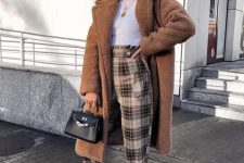 With white t-shirt, black bag, white sneakers and brown midi coat