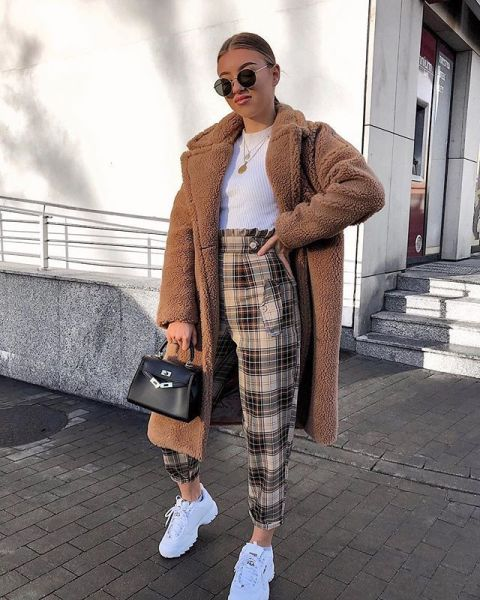 With white t shirt, black bag, white sneakers and brown midi coat