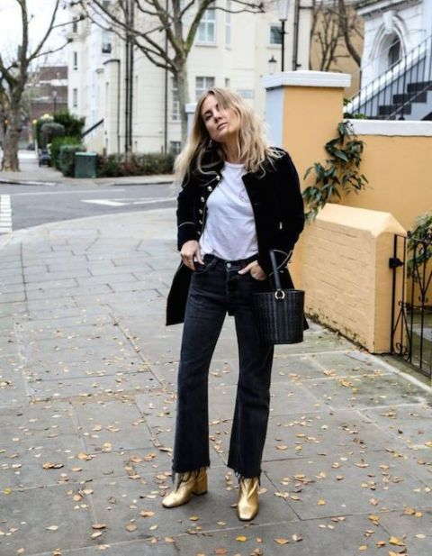 With white t-shirt, black blazer, flare jeans and black bag