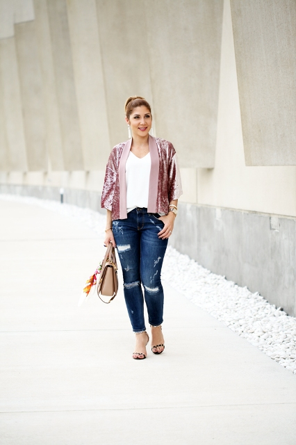 With white top, skinny jeans, beige bag and leopard high heels