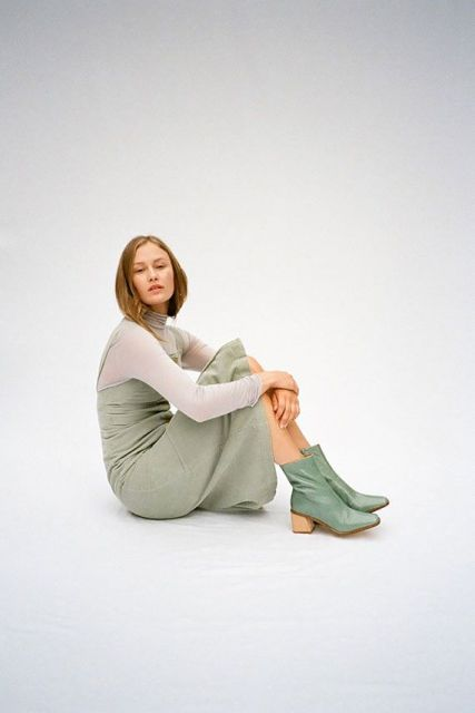 With white turtleneck and mint green dress