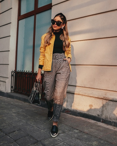 With yellow jacket, black sweater, transparent bag and shoes