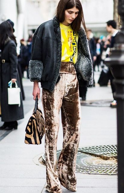 With yellow labeled t-shirt, printed bag, black jacket and high heels