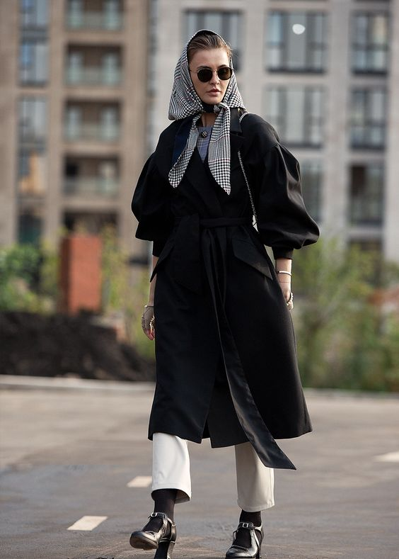 a black coat and a plaid black and white headscarf for accenting a monochromatic outfit
