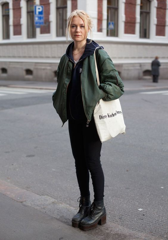 a black hoodie, skinnies, platform boots, a green bomber jacket and a tote for a cozy winter look