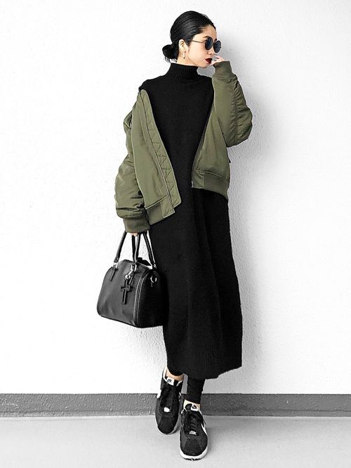 a black midi sweater dress, black trainers and tights, a black bag and a green bomber jacket for winter