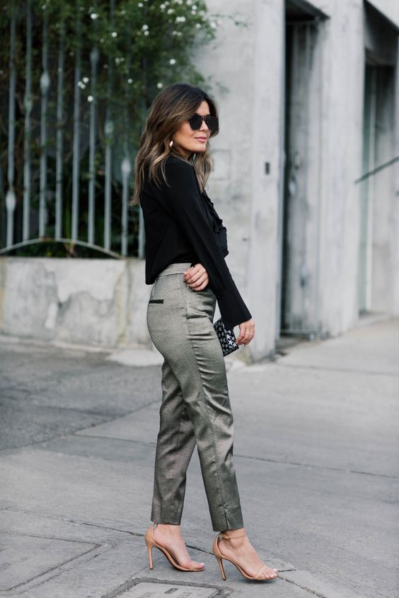 a black sweater, green metallic pants, nude heels and a printed clutch for a stylish winter outfit