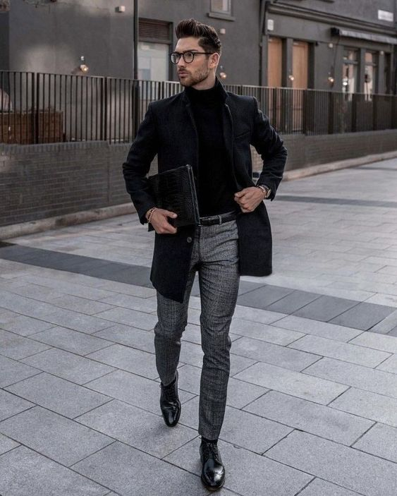 a black turtleneck, a black tweed blazer, grey pant and black shoes for a monochromatic winter look