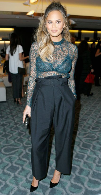 a blue lace sheer top over a matching bra, black wideleg pants, black shoes for a sexy and stylish look