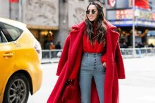a bold holiday look with a red sweater, high waisted blue skinnies, red shoes, a red faux fur coat and a red bag