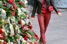a bold outfit with a red sweater, red plaid pants, leopard print boots, a black leather jacket and a red bag