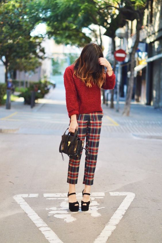 a burgundy sweater, plaid cropped pants, black platform shoes and a black bag for a cozy feel