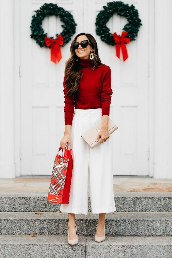 a burgundy turtleneck, white culottes, nude shoes and a neutral clutch plus statement earrings