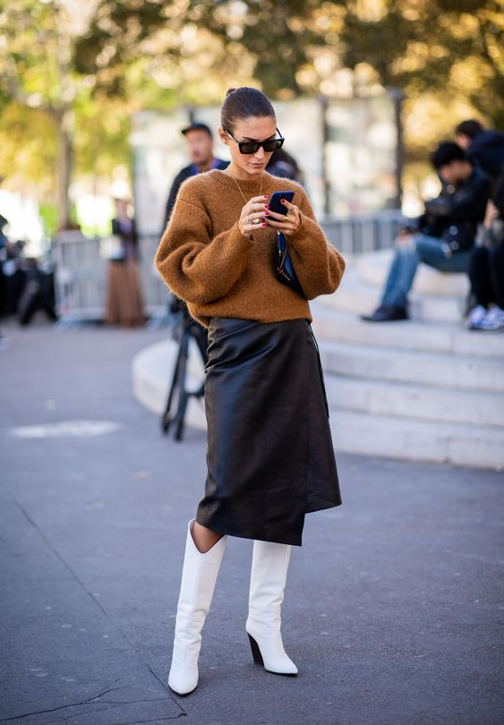 a camel sweater, a black leather wrap midi, white knee high boots for a stylish and very modern look